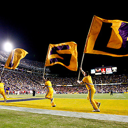 November 17, 2012; Baton Rouge, LA, USA;  LSU Tigers cheerleaders carry a LSU flag following a touchdown against the Ole Miss Rebels during the fourth quarter at Tiger Stadium. LSU defeated Ole Miss 41-35. Mandatory Credit: Derick E. Hingle-US PRESSWIRE