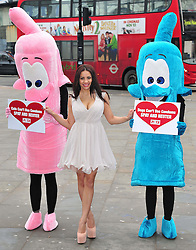 Lacey Banghard at PETA photocall.  Model and recent evictee from the Celebrity Big Brother house joins two PETA activists dressed as giant condom to promote the sterilisation of cats and dogs. Banghard, 20, will posed with a sign reading 'Dogs and Cats Can't Wear Condoms: Spay and Neuter'.  Eros statue, Piccadilly Circus, London, United Kingdom, January 22, 2013. Photo by Nils Jorgensen / i-Images..