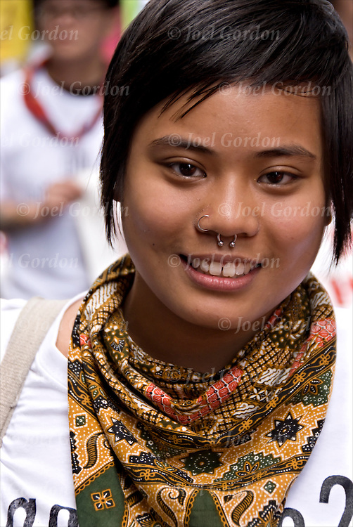 Punk young adult female smiling with nose rings during the Philippine Independence Day Parade is a celebration for the Filipino American community in the Northeast United States.