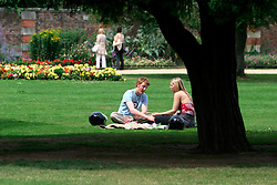 UK ENGLAND SURREY HAMPTON COURT PALACE 19JUL04 - A couple enjoys a picknick at the East Front Garden at Hampton Court Palace. The Palace and its famous royal gardens were founded by King Henry VIII in the sixteenth century and were developed through the centuries by subsequent sovereigns, determined to have the most fashionable and elegant gardens of their era. 2004 is the Year of the Garden at Hampton Court Palace and it is celebrated by a series of special events like the Tudor-costumed garden tours.....jre/Photo by Jiri Rezac ....© Jiri Rezac 2004....Contact: +44 (0) 7050 110 417..Mobile:  +44 (0) 7801 337 683..Office:  +44 (0) 20 8968 9635....Email:   jiri@jirirezac.com..Web:    www.jirirezac.com....© All images Jiri Rezac 2004 - All rights reserved.