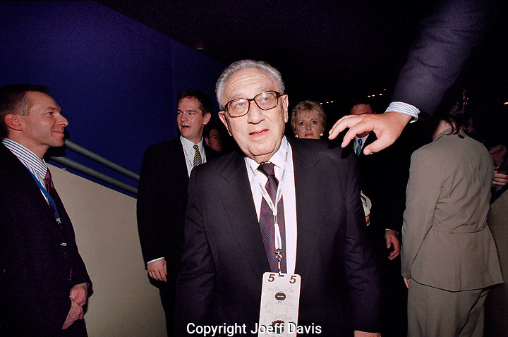 PHILADELPHIA, PA - August 3, 2000- Henry Kissenger about to be grabbed by the hand of god to atone for his sins of death and war at the 2000 Republican National Convention at the Wachovia Center in Philadelphia, Pennsylvania.