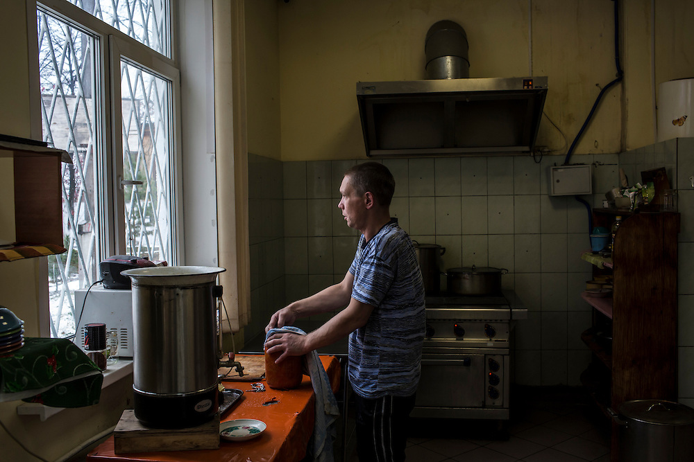 YEKATERINBURG, RUSSIA - OCTOBER 16: Andrei, a former drug addict who cooks for the rest of the patients in treatment for drug addiction at City Without Drugs, works in the kitchen on October 16, 2013 in Yekaterinburg, Russia. City Without Drugs is a well-known narcotics treatment program in Russia founded by Yevgeny Roizman, who was elected mayor of Yekaterinburg in September 2013. (Photo by Brendan Hoffman/Getty Images) *** Local Caption ***