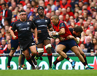 Rugby Union - 2016 / 2017 European Rugby Champions Cup - Semi-Final: Munster vs. Saracens<br /> <br /> Munster's Simon Zebo is tackled by Sean Maitland of Saracens  at the Aviva Stadium, Dublin.<br /> <br /> COLORSPORT/KEN SUTTON