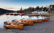 Boats beside Windermere at Dusk in early spring.