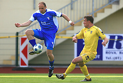 Milan Osterc of Gorica vs Ivan Knezovic at 32th Round of Slovenian First League football match between NK Domzale and NK Hit Gorica in Sports park Domzale, on May 6, 2009, in Domzale, Slovenia. Gorica won 2:0. (Photo by Vid Ponikvar / Sportida)