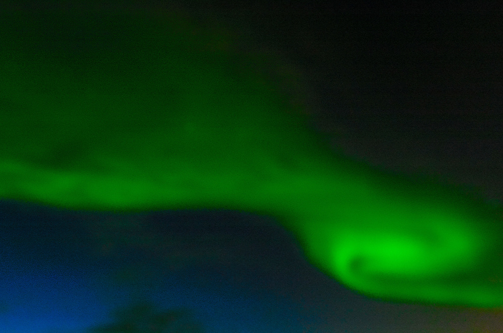 "The Aurora Borealis, or Northern Lights, shines above the Arctic sea, Greenland. Greenland (Greenlandic: Kalaallit Nunaat, meaning ""Land of the Kalaallit (Greenlanders) is a self-governing Danish province located between the Arctic and Atlantic Ocean. A recent study by researchers from NASA's Goddard Space Flight Center shows that Greenland's ice sheet, about 8% of the Earth's grounded ice, is losing ice mass."
