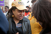 NAACP- Baltimore President Tessa Hill Aston talks with a reporter at a rally in support of Trayvon Martin in front of city hall in downtown Baltimore, MD on Monday, March 26, 2012. The rally, in support of Trayvon Martin, the 17-year-old who was unarmed when he was shot and killed on Feb. 26 by neighborhood watch volunteer George Zimmerman.