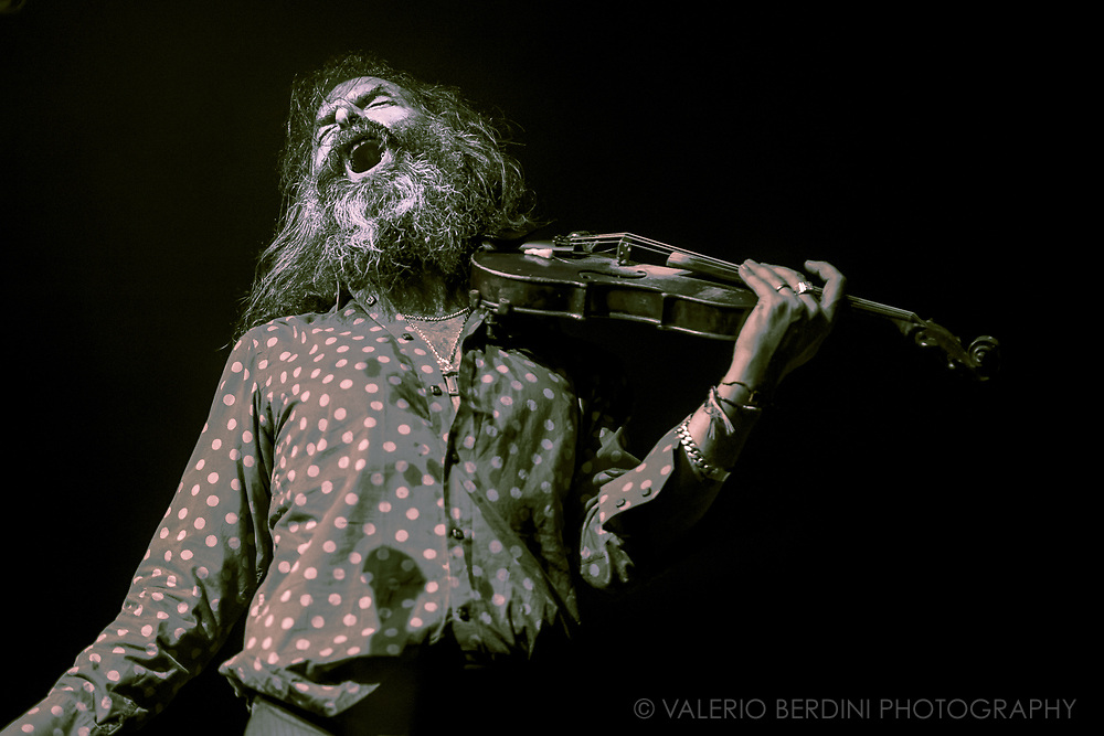 Warren Ellis live on stage leading his band, the Dirty Three, at I'll Be Your Mirror Festival at Alexandra Palace in London