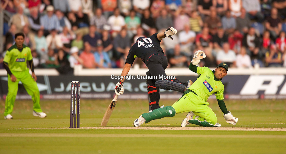 Michael Yardy in past wicket keeper Kamran Akmal during the first T20 international between England and Pakistan in Cardiff.  Photo: Graham Morris (Tel: +44(0)20 8969 4192 Email: sales@cricketpix.com) 05/09/10