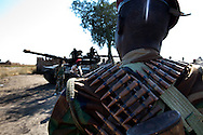 SPLA troops walk past a tank in South Sudan's most northern barracks in Upper Nile State.