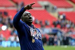 Adebayo Akinfenwa of AFC Wimbledon celebrates winning the League Two Playoff Final - Mandatory by-line: Robbie Stephenson/JMP - 30/05/2016 - FOOTBALL - Wembley Stadium - London, England - AFC Wimbledon v Plymouth Argyle - Sky Bet League Two Play-off Final