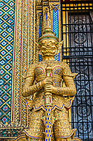 golden yaksha demon portrait at Phra Mondop grand palace Bangkok Thailand
