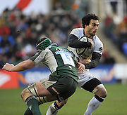 Twickenham, GREAT BRITAIN, Newcastles',  Tane TU'IPULOTU,  tries to evade, Bob CASEY's tackle, during the Guinness Premiership match,  London Irish vs Newcastle Falcon at the Madjeski  Stadium, Reading. on Sat )3.01.2009. [Photo, Peter Spurrier/Intersport-images]