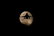 Holland - <br /> Fighter Planes Takes Off into Stunning Full Moon<br /> Royal Netherlands Air Force F-16AM with callsign 'Metal 1' takes off from Volkel airbase for a night sortie and crosses the early evening moon.<br /> ©Jos Frielink/Exclusivepix