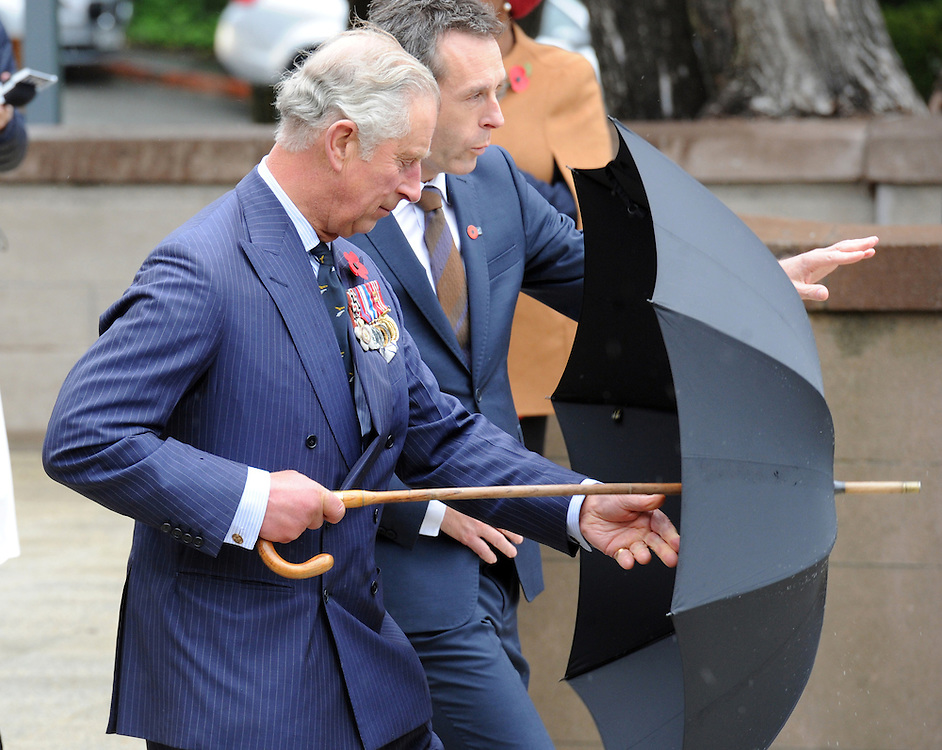 Prince Charles, Prince of Wales, raises his umbrella after laying a wreath at the National War Memorial, Wellington, New Zealand, Wednesday, November 04, 2015.. Credit:SNPA / Ross Setford