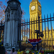 Thousands Unite for Europe March in Parliament square, on 25th March 2017. Placards and Flower tributes to the victims of terror attacks hanging at the Parliament aftermate,London,UK. by See Li