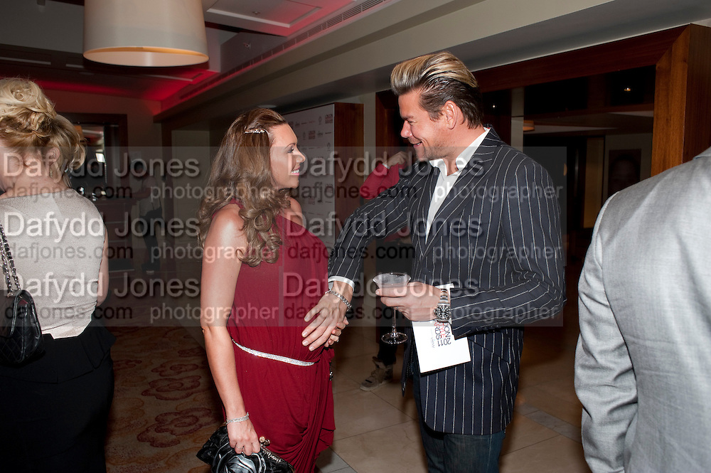 MICHELLE HEATON; PHILIP TURNER, London Lifestyle Awards. Riverbank Park Plaza. London.6 October 2011. <br /> <br />  , -DO NOT ARCHIVE-© Copyright Photograph by Dafydd Jones. 248 Clapham Rd. London SW9 0PZ. Tel 0207 820 0771. www.dafjones.com.