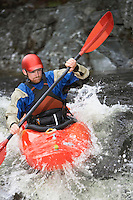 Man kayaking in river