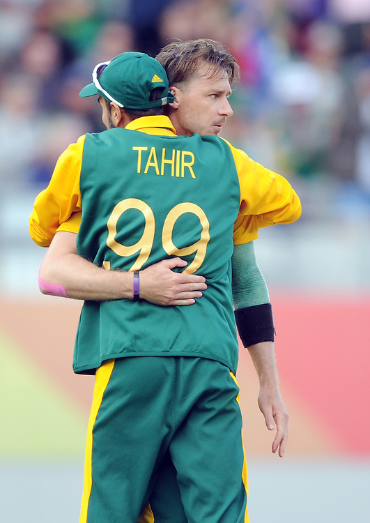 South Africa's Dale Steyn, right, is hugged by Muhammad Imran Tahir after dismissing Pakistan's Shahid Afridi for 22 in the ICC Cricket World Cup at Eden Park, Auckland, New Zealand, Saturday, March 07, 2015. Credit:SNPA / Ross Setford