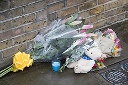 © Licensed to London News Pictures.20/03/2017.London, UK. A teddy bear and floral tributes are left outside the house where one baby was found dead and another seriously injured in Finsbury Park, East London. Bidhya Sagar Das, 33, believed to be the children's father, has been arrested. Photo credit: Peter Macdiarmid/LNP