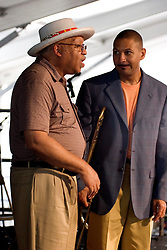 April 23rd, 2005. New Orleans, Louisiana,  USA. <br /> New Orleans Jazz and Heritage Festival. JazzFest.<br /> Legendary Jazz pianist Ellis Marsalis and son Delfeayo plays the Jazz tent.<br /> Ellis Marsalis passed away April 1st 2020 of complications associated with Coronavirus - COVID-19.<br /> Photo ©; Charlie Varley/varleypix.com