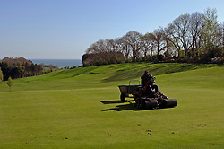 "NORMANDY, FRANCE - MAY-01-2007 - Omaha Beach Golf Club -  A member of the grounds crew works on the green of hole 9 of ""The Sea"" course. (Photo © Jock Fistick)"