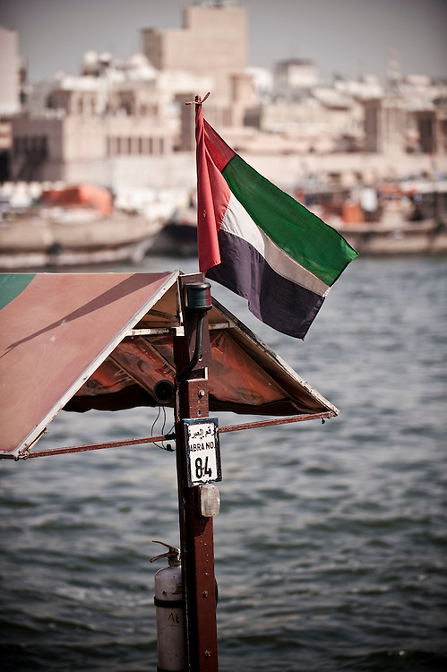 UAE flags flutter on abras on the Dubai creek, Bur Dubai, Dubai, UAE. Archive of images of Dubai by Dubai photographer Siddharth Siva