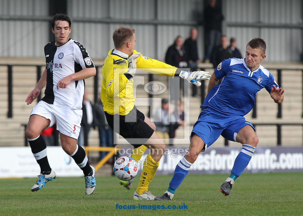 Jake Reed of Lowestoft Town wins the challenge against the Dave Parton of Hednesford Town, before scoring the first goal against Hednesford during the National League North match at Keys Park, Hednesford.<br /> Picture by Michael Sedgwick/Focus Images Ltd +44 7900 363072<br /> 03/10/2015