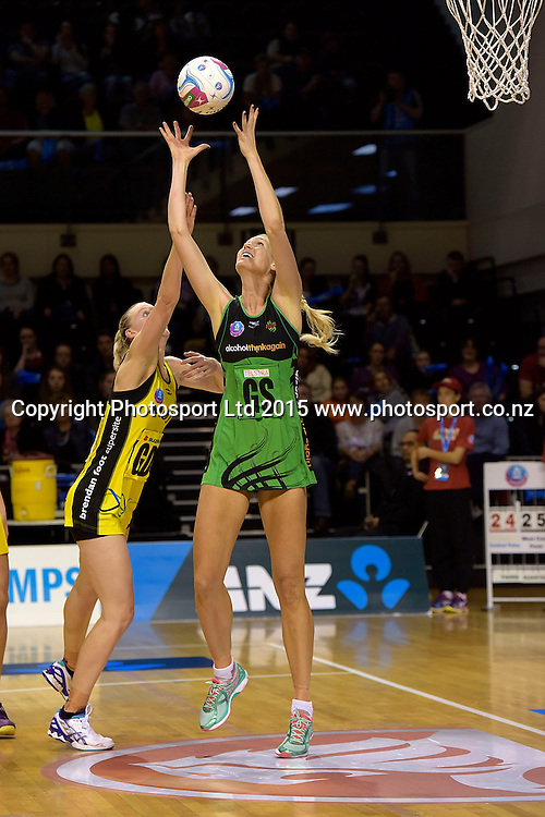 Fever's Caitlin Bassett takes a pass with Pulse's captain Katrina Grant (L) in defense during the ANZ Championship - Pulse v Fever netball match at the TSB Arena in Wellington on Monday the 19th of April 2015. Photo by Marty Melville / www.Photosport.co.nz