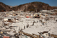 Japanese forces work in the town of Taro looking for dead bodies after the earthquake and tsunami hit the city on 11 March 2011.