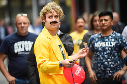 "© Licensed to London News Pictures. 05/09/2018. LONDON, UK. A fundraising volunteer prepares joins fans of Freddie Mercury and members of the public in Carnaby Street donning moustaches during ""Freddie for a Day"", a fundraising event in aid of the Mercury Phoenix Trust on Freddie Mercury's birthday.  Queen tribute band ""Bulsara and the Queenies"" sang iconic songs entertaining crowds.  Photo credit: Stephen Chung/LNP"
