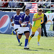 Manu Samoa's Patrick Faapale outpaces Australia for an early first half try at the USA Sevens Rugby at Sam Boyd Stadium, Las Vegas, Nevada, USA.  Photo by Barry Markowitz, 2/9/13.  Courtesy Samoa Tuna Processors/Tri Marine