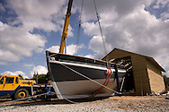 "The Spirit of Mystery leaves her build shed..Yachtsman Pete Goss and his team have built a 37ft Cornish Lugger to follow in the wake of the Mystery which sailed from Cornwall to Australia in 1854...Pictures of the yacht a she is lifted out of the shed and has her masts stepped today.Milbrook. Cornwall. UK..For further info please contact ""Formedia"".Telephone : +44 (0) 1752 764222..Email: stuart@formedia.co.uk"