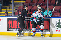 KELOWNA, CANADA - JANUARY 16:  Jett Woo #4 of the Moose Jaw Warriors checks Liam Kindree #26 of the Kelowna Rockets on January 16, 2019 at Prospera Place in Kelowna, British Columbia, Canada.  (Photo by Marissa Baecker/Shoot the Breeze)