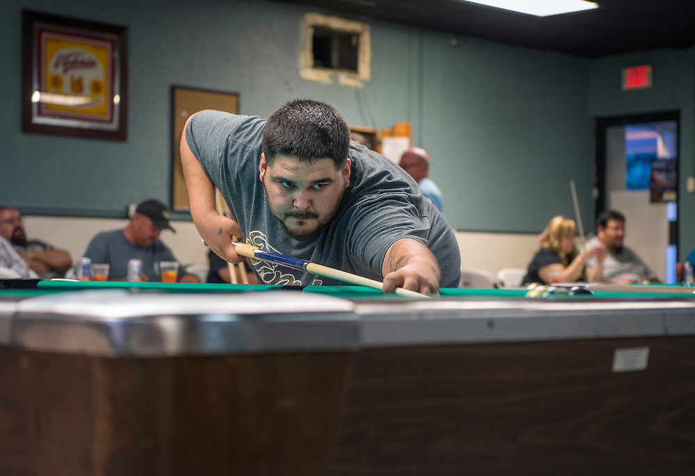 em071817k/jnorth/Jovani De La O, a member of the Saloon Shots billards team, plays 9 ball at the Faternal Order of the Eagle club, in Las Vegas, Tuesday July 18, 2017. The billards team is headed to Las Vegas Nevada to compete nationally. (Eddie Moore/Albuquerque Journal)