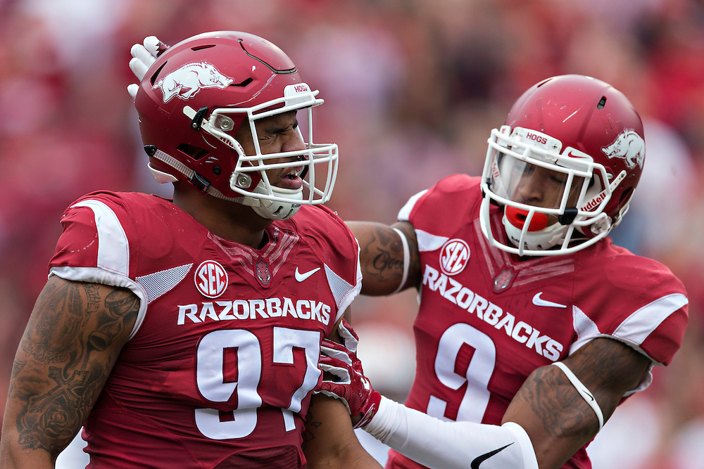 FAYETTEVILLE, AR - OCTOBER 24:  Santos Ramirez #9 celebrates with Tevin Beanum #97 of the Arkansas Razorbacks after making a tackle during a game against the Auburn Tigers at Razorback Stadium on October 24, 2015 in Fayetteville, Arkansas.  The Razorbacks defeated the Tigers in 4 OT's 54-46.  (Photo by Wesley Hitt/Getty Images) *** Local Caption *** Santos Ramirez; Tevin Beanum