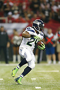 ATLANTA, GA - JANUARY 13: Marshawn Lynch #24 of the Seattle Seahawks runs with the ball against the Atlanta Falcons during the NFC Divisional Playoff Game at Georgia Dome on January 13, 2013 in Atlanta, Georgia. The Falcons defeated the Seahawks 30-28. (Photo by Joe Robbins) *** Local Caption *** Marshawn Lynch