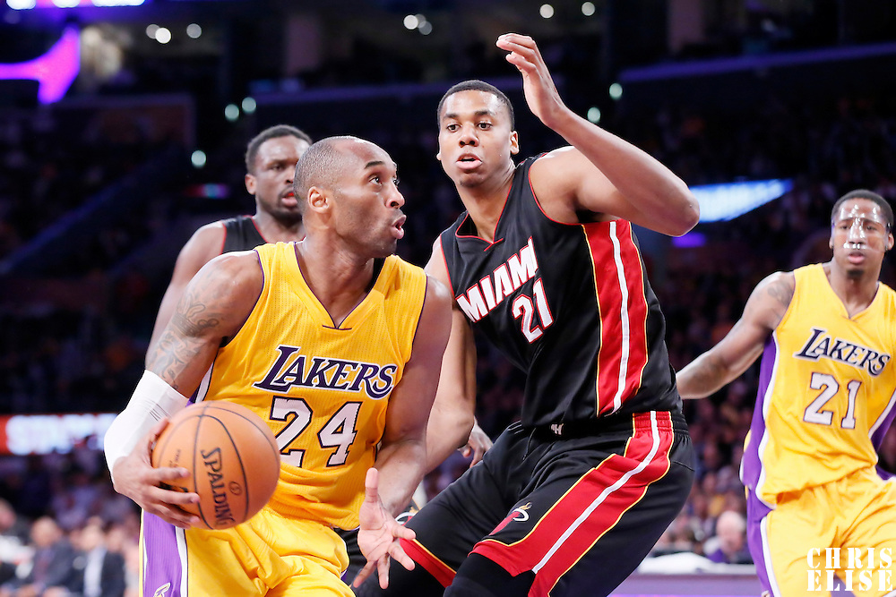 13 January 2014: Los Angeles Lakers guard Kobe Bryant (24) drives past Miami Heat center Hassan Whiteside (21) during the Miami Heat 78-75 victory over the Los Angeles Lakers, at the Staples Center, Los Angeles, California, USA.