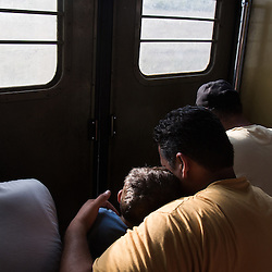 Refugees travel by train to the border with Serbia, after crossing into Macedonia near the town of Gevgelija on August 26, 2015. After crossing from Greece into Macedonia, the refugees are held at a reception center near the town of Gevgelija. To transit through Macedonia they receive a document allowing them 72 hours to apply for asylum or leave the country. Most continue north by train, bus or taxi to other European states.