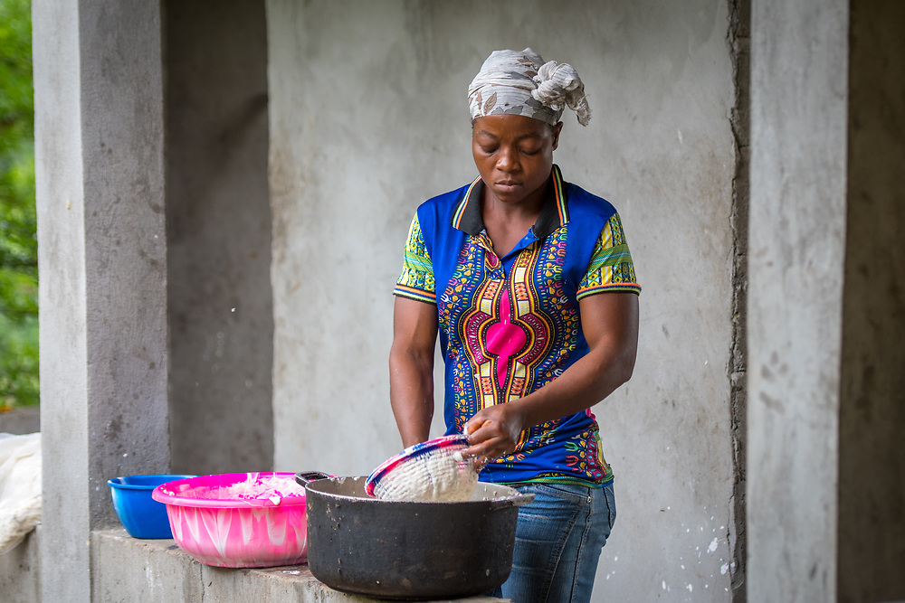 A woman prepares Cassava based Fufu dough in Ganta, Liberia