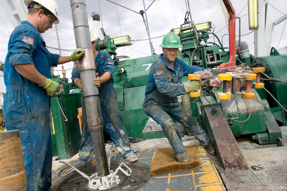 JONAH FIELD, SUBLETTE COUNTY, WY - On a gas well drill rig in the Jonah Field, Wy., on August 8, 2005. Encana, BP, and Ultra Petroleum are the main operators in the 30,200 acre field, but Encana is expected to drill two thirds of the wells to yield upwards of 10.5 trillion cubic feet of natural gas which has a current market value of $55 to $60 billion dollars. Encana could make $2 billion in profit per TCF depending price trends and production costs. Jonah Field operators are seeking an 'in-fill' project which will allow for an increase of wells from the currently permitted 533 to 3100 by decreasing well pad spacing from 40 acres to 20 acres and possibly down to 10 acres spacing. This will allow for a greater number of vertical as opposed to directionally drilled wells. Vertical wells take less time, are easier, and therefore cheaper to drill but require a greater amount of surface disturbance. Development and completion, the drilling and hooking up of wells to pipelines, is expected to take 10-15 years while area gas reserves are expected to last 40-60 years. .