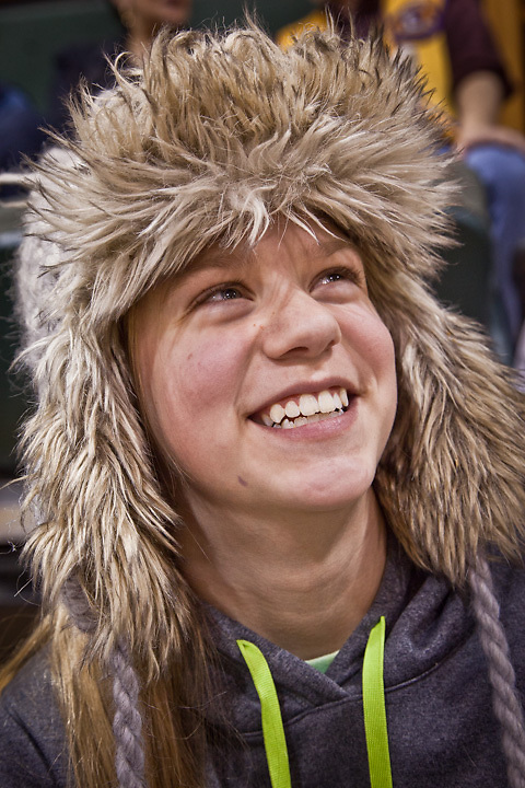 Spectaor and young basketball player, Larissa Parker, UAA Women's basketball game, Anchorage