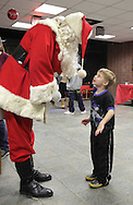 Middletown, New York - A young boy tells Santa what he wants for Christmas at the Middletown YMCA on Dec. 4, 2010.