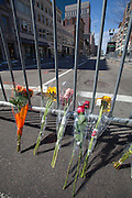 Flowers lay against a barricade near the finish line of the Boston Marathon and the site of deadly twin bombings a day earlier, in Boston, Massachusetts, USA on 16 April 2013. At least three people died and more than a hundred were injured in an apparent terrorist attack in the northeastern US city.