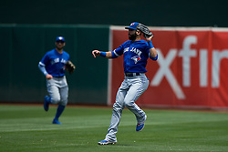 OAKLAND, CA - JULY 23:  Jose Bautista #19 of the Toronto Blue Jays catches a fly ball hit off the bat of Ben Zobrist (not pictured) of the Oakland Athletics during the third inning at O.co Coliseum on July 23, 2015 in Oakland, California. The Toronto Blue Jays defeated the Oakland Athletics 5-2. (Photo by Jason O. Watson/Getty Images) *** Local Caption *** Jose Bautista