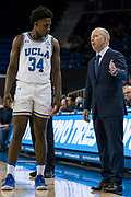 UCLA Bruins head coach Mick Cronin speaks with guard David Singleton (34) during an NCAA college basketball game against the San Jose State Spartans, Sunday, Dec. 1, 2019, in Los Angeles. UCLA defeated San Jose State 93-64. (Jon Endow/Image of Sport)