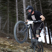 Phil Leonard from Auckland tackles the Ben Lomond Forest course high above Queenstown during practice for the Corona Dirtmasters Downhill event in Queenstown, Central Otago, which takes place on Sunday. The technically demanding course will start at the Gondola and finish in Brecon Street. The event was part of the inaugural Queenstown Bike Festival, taking place from 16th-25th April. The event hopes to highlight Queenstown's growing profile as one of the three leading biking centres in the world. Queenstown, Central Otago, New Zealand. 22nd April 2011. Photo Tim Clayton..