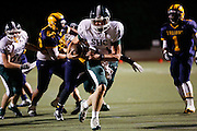 Sacred Heart Cathedral quarterback Logan White (11) carries the ball against Milpitas High School at Milpitas High School in Milpitas, California, on September 20, 2013. The Trojans beat the Fightin' Irish 28-21. (Stan Olszewski/SOSKIphoto)