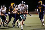 Sacred Heart Cathedral quarterback Logan White (11) carries the ball against Milpitas High School at Milpitas High School in Milpitas, California, on September 20, 2013. The Trojans beat the Fightin' Irish 28-21. (Stan Olszewski/SOSKIphoto)
