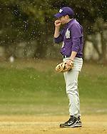 Monroe-Woodbury pitcher Mike Schifano tries to keep his hand warm while snow flurries fall during a game against Valley Central in Pine Bush on April 5, 2007. The game was part of the Anaconda Tournament.